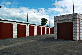 Об утверждении административного регламента о предоставлении земельного участка, на котором расположены гаражи, в собственность бесплатно